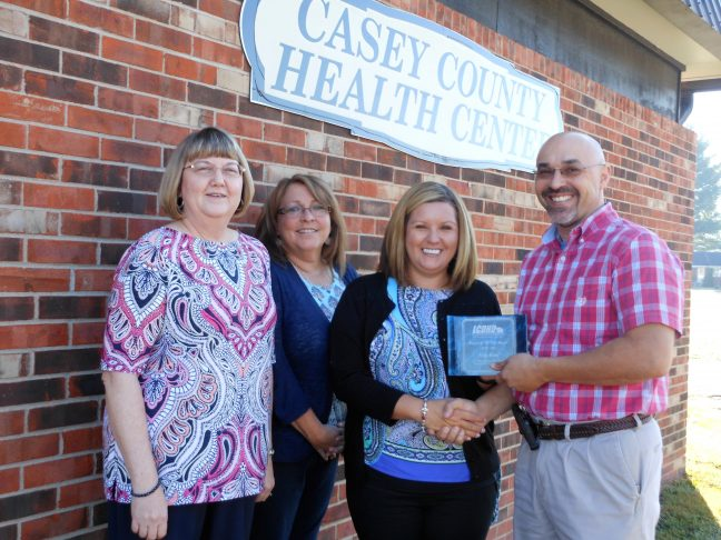 Pictured font, L to R: Sandy Porter, Casey Office Manager; Melinda Copenhaver, District Administrative Support Director; Kim Kane, Casey Senior Support Associate; Shawn D. Crabtree, Executive Director